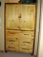 Log T.V. Armoire with Flipper Doors